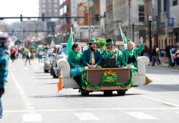 People on a float during the St. Patrick's Day Parade